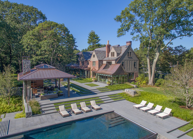 Drone_view_of_Tudor_mansion_with_pool_house
