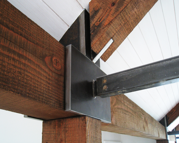 Timber and metal intersection with ceiling
