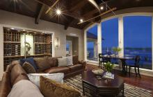 Coastal Mediterranean gathering room and wine cellar