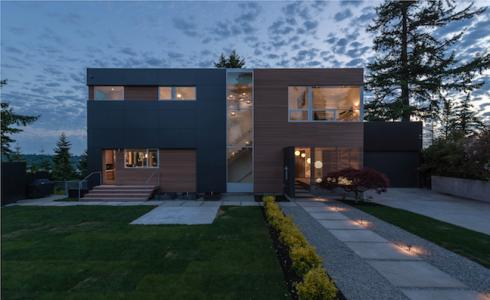 Exterior, dusk, of modern home by Build LLC in Seattle